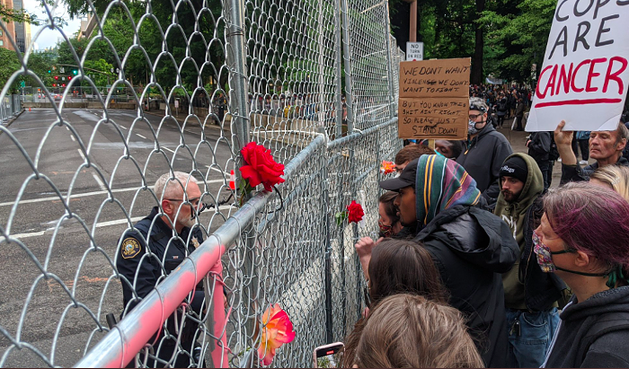 A scene from Sunday evenings protest. Featuring: The Fence.
