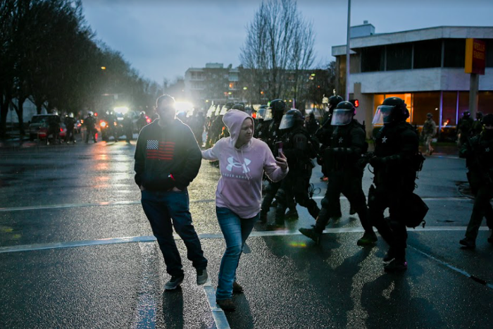 Protesters film police during a right-wing rally in Salem.
