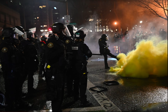 Police respond to the New Years Eve protest in downtown Portland.