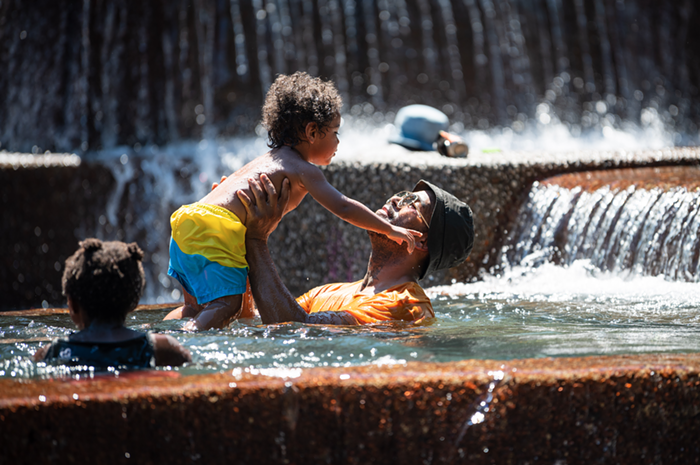 Portlanders keeping cool in the Keller Fountain during Sundays edition of the heatwave.