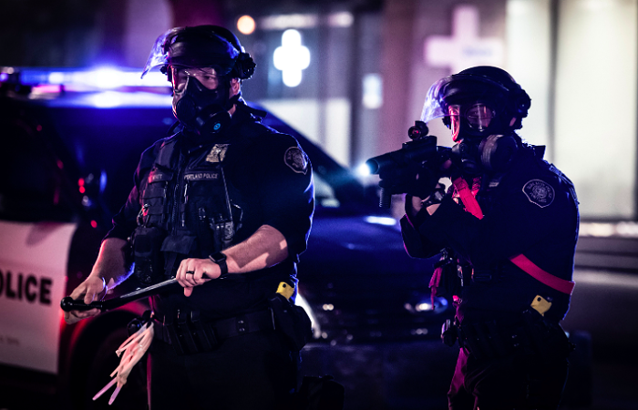 The Feds crack down on Portland cops for their violent reaction to Portland protests.