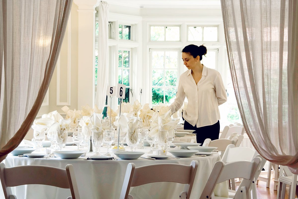 server setting the table at formal event