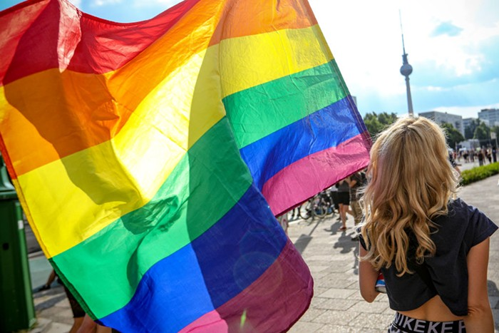 a person carrying a pride flag