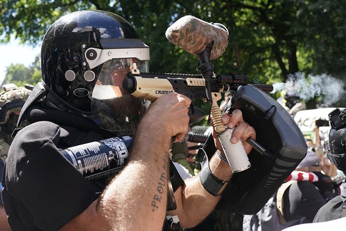 A man holding a paintball gun